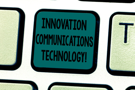 Text sign showing Innovation Communications Technology. Conceptual photo Improvement in services and devices Keyboard key Intention to create computer message pressing keypad idea 写真素材