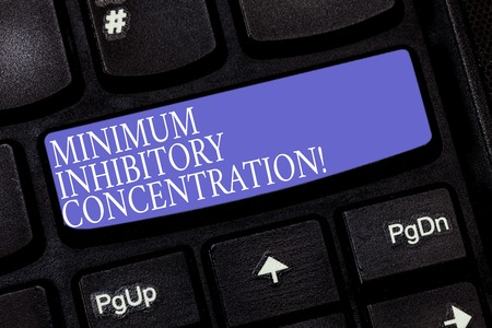 Handwriting text Minimum Inhibitory Concentration. Concept meaning lowest concentration of a chemical Keyboard key Intention to create computer message pressing keypad idea