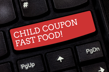 Writing note showing Child Coupon Fast Food. Business photo showcasing Ticket discount savings junk meals for kids Keyboard key Intention to create computer message pressing keypad idea Фото со стока