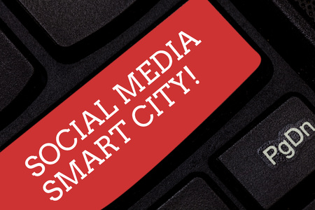 Writing note showing Social Media Smart City. Business photo showcasing Connected technological advanced modern cities Keyboard key Intention to create computer message pressing keypad idea