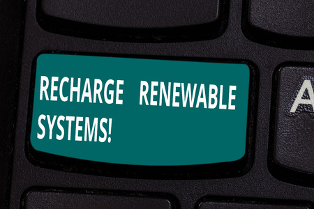 Word writing text Recharge Renewable Systems. Business concept for Clean and sustainable energy and nonpolluting Keyboard key Intention to create computer message pressing keypad idea