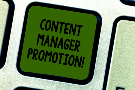Writing note showing Content Manager Promotion. Business photo showcasing someone who oversees the content presented Keyboard key Intention to create computer message pressing keypad idea 写真素材