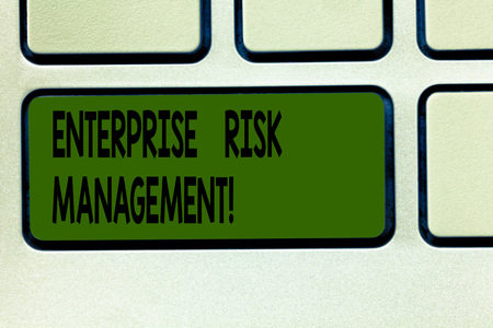 Writing note showing Enterprise Risk Management. Business photo showcasing analysisage risks and seize business opportunities Keyboard key Intention to create computer message pressing keypad idea