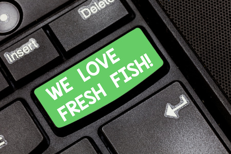 Handwriting text We Love Fresh Fish. Concept meaning Seafood lovers healthy food marine cooking culinary arts Keyboard key Intention to create computer message pressing keypad idea