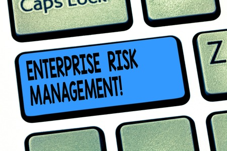 Word writing text Enterprise Risk Management. Business concept for analysisage risks and seize business opportunities Keyboard key Intention to create computer message pressing keypad idea