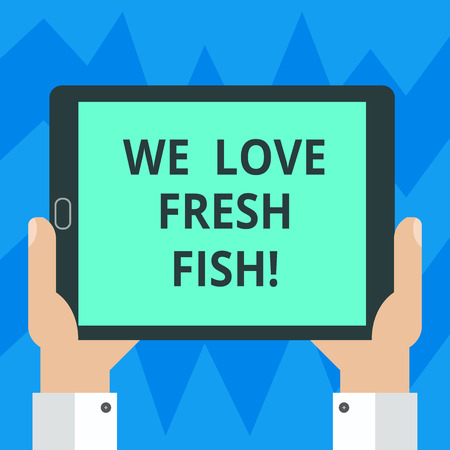 Text sign showing We Love Fresh Fish. Conceptual photo Seafood lovers healthy food marine cooking culinary arts Hu analysis Hand Holding Blank Screen Tablet Smartphone Display Unit photo 写真素材