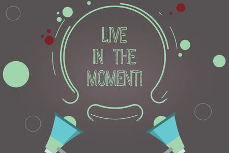 Handwriting text Live In The Moment. Concept meaning Be inspired motivated enjoy today happy moments Two Megaphone and Circular Outline with Small Circles on Color Background Stock Photo