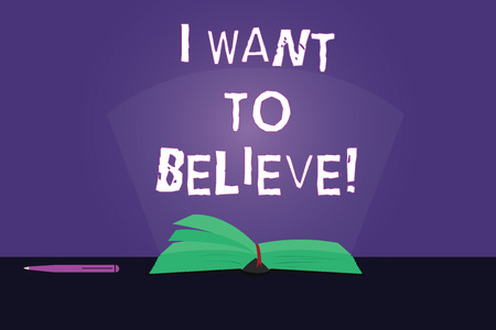 Writing note showing I Want To Believe. Business photo showcasing Eager of being faithful positive motivation inspirational Color Pages of Book on Table with Pen and Light Beam Glaring