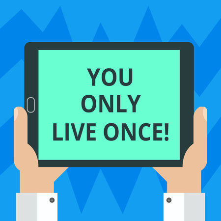 Text sign showing You Only Live Once. Conceptual photo Seize the day and be happy motivated enjoy life Hu analysis Hand Holding Blank Screen Tablet Smartphone Display Unit photo Stock Photo