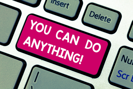Text sign showing You Can Do Anything. Conceptual photo Motivation for doing something Believe in yourself Keyboard key Intention to create computer message pressing keypad idea