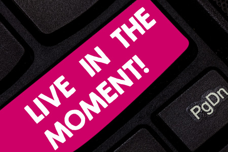 Conceptual hand writing showing Live In The Moment. Business photo text Be inspired motivated enjoy today happy moments Keyboard key Intention to create computer message idea Stock Photo
