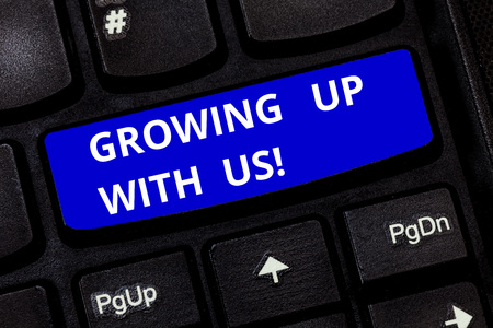 Text sign showing Growing Up With Us. Conceptual photo Offering help assistance to make your business grow Keyboard key Intention to create computer message pressing keypad idea Stock Photo