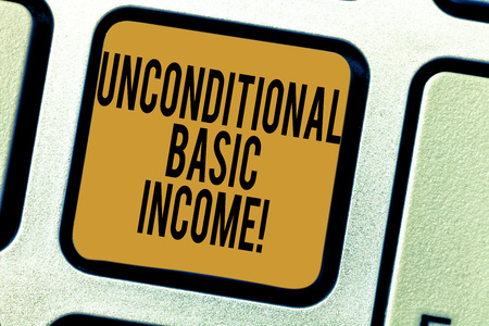 Handwriting text writing Unconditional Basic Income. Concept meaning paid income without a requirement to work Keyboard key Intention to create computer message pressing keypad idea