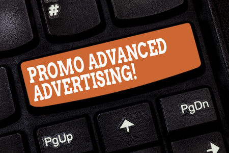 Handwriting text writing Promo Advanced Advertising. Concept meaning inform target audiences the merits of a product Keyboard key Intention to create computer message pressing keypad idea Stock Photo