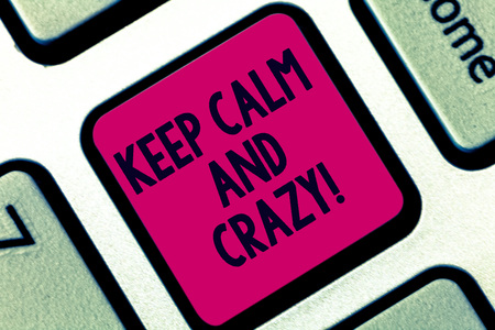 Handwriting text Keep Calm And Crazy. Concept meaning Relax and go insane happy get excited celebrate Keyboard key Intention to create computer message pressing keypad idea Stock Photo