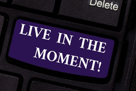 Writing note showing Live In The Moment. Business photo showcasing Be inspired motivated enjoy today happy moments Keyboard key Intention to create computer message pressing keypad idea
