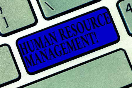 Text sign showing Human Resource Management. Conceptual photo process of hiring and developing employees Keyboard key Intention to create computer message pressing keypad idea