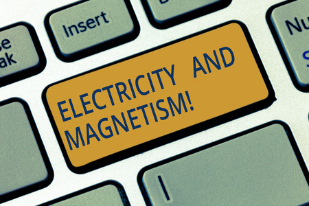 Conceptual hand writing showing Electricity And Magnetism. Business photo showcasing Embodies a single core electromagnetic force Keyboard key Intention to create computer message idea