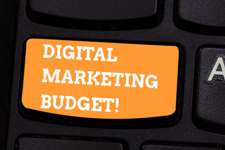 Conceptual hand writing showing Digital Marketing Budget. Business photo text Cost that will be required to promote products Keyboard key Intention to create computer message idea