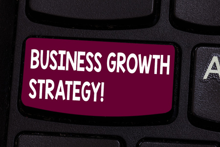 Text sign showing Business Growth Strategy. Conceptual photo Larger market share Market penetration Acquisition Keyboard key Intention to create computer message pressing keypad idea 写真素材