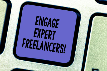 Text sign showing Engage Expert Freelancers. Conceptual photo Hiring skilled contractors for a short time work Keyboard key Intention to create computer message pressing keypad idea Stock Photo