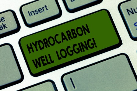 Handwriting text writing Hydrocarbon Well Logging. Concept meaning record of the geologic formations of a borehole Keyboard key Intention to create computer message pressing keypad idea