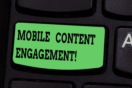 Writing note showing Mobile Content Engagement. Business photo showcasing Pushing compelling experiences to mobile users Keyboard key Intention to create computer message pressing keypad idea