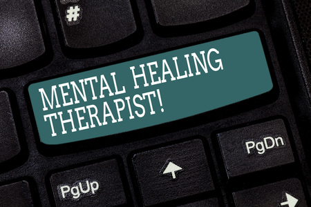 Handwriting text writing Mental Healing Therapist. Concept meaning Counseling or treating clients with mental disorder Keyboard key Intention to create computer message pressing keypad idea