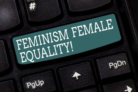 Handwriting text writing Feminism Female Equality. Concept meaning advocacy of women s is rights on equality of sexes Keyboard key Intention to create computer message pressing keypad idea