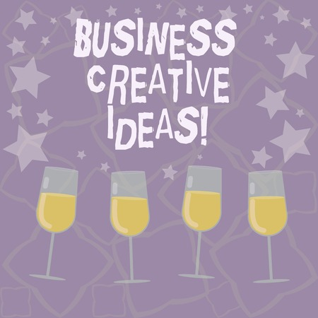 Writing note showing Business Creative Ideas. Business photo showcasing Concept that can be used for financial gain Filled Cocktail Wine Glasses with Scattered Stars as Confetti Stemware