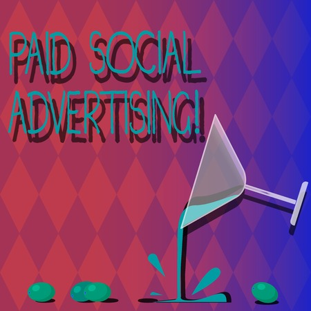 Handwriting text Paid Social Advertising. Concept meaning external marketing efforts involve a paid placement Cocktail Wine Glass Pouring Liquid with Splash Grapes and Shadow photo