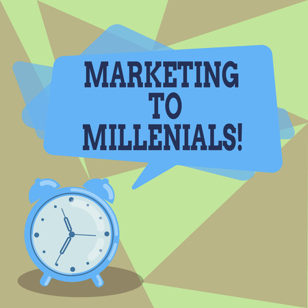 Text sign showing Marketing To Millenials. Conceptual photo Be socially connected Internet savvy and stay mobile Blank Rectangular Color Speech Bubble Overlay and Analog Alarm Clock Stock Photo