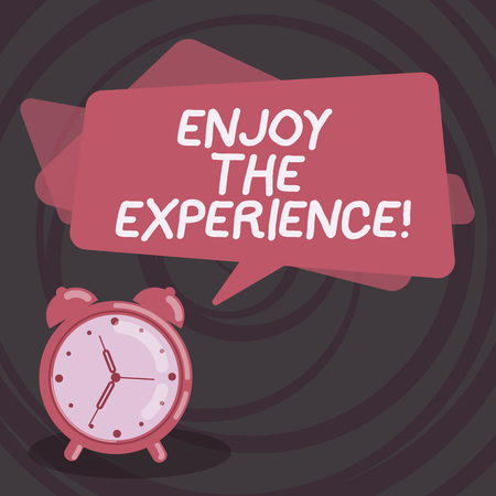 Word writing text Enjoy The Experience. Business concept for Taking pleasure in the situation that you are in Blank Rectangular Color Speech Bubble Overlay and Analog Alarm Clock