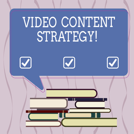 Conceptual hand writing showing Video Content Strategy. Business photo text use specific video format according to buying stages Uneven Pile of Hardbound Books and Rectangular Speech Bubble 版權商用圖片