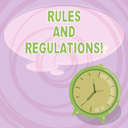 Writing note showing Rules And Regulations. Business photo showcasing guidelines to follow when entering into a transaction Blank Color Thought Speech Bubble with Outline and Alarm Clock photo