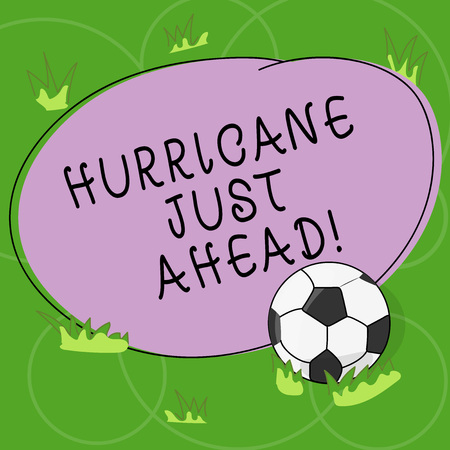 Word writing text Hurricane Just Ahead. Business concept for violent tropical cyclone is approaching to hit the land Soccer Ball on the Grass and Blank Outlined Round Color Shape photo