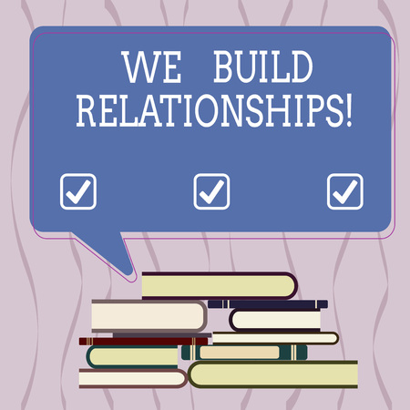 Conceptual hand writing showing We Build Relationships. Business photo text develop mutual affiliation between individuals Uneven Pile of Hardbound Books and Rectangular Speech Bubble