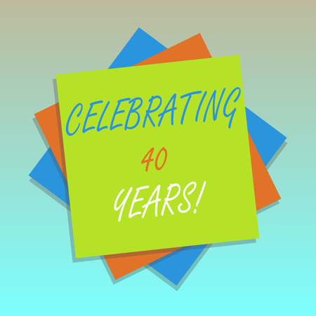 Handwriting text Celebrating 40 Years. Concept meaning Honoring Ruby Jubilee Commemorating a special day Multiple Layer of Blank Sheets Color Paper Cardboard photo with Shadow
