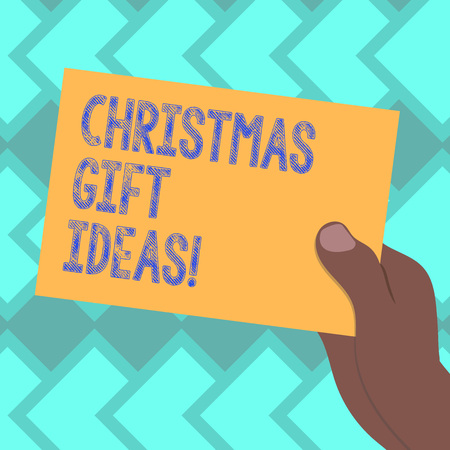 Text sign showing Christmas Gift Ideas. Conceptual photo Suggestion for best presents to give in Christmas day Drawn Hu analysis Hand Holding Presenting Blank Color Paper Cardboard photo