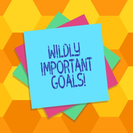 Handwriting text Wildly Important Goals. Concept meaning most important objective that needs special attention Multiple Layer of Blank Sheets Color Paper Cardboard photo with Shadow Imagens - 115882688