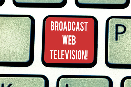 Conceptual hand writing showing Broadcast Web Television. Business photo showcasing media presentation dispersed over the Internet Keyboard key Intention to create computer message idea