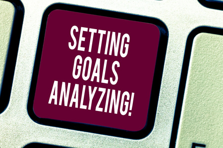 Text sign showing Setting Goals Analyzing. Conceptual photo Helped to be realistic about what can really achieve Keyboard key Intention to create computer message pressing keypad idea Imagens