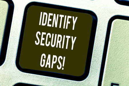Conceptual hand writing showing Identify Security Gaps. Business photo text determine whether the controls in place are enough Keyboard key Intention to create computer message idea Imagens