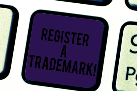 Conceptual hand writing showing Register A Trademark. Business photo text To record or list as official company brand or logo Keyboard key Intention to create computer message idea