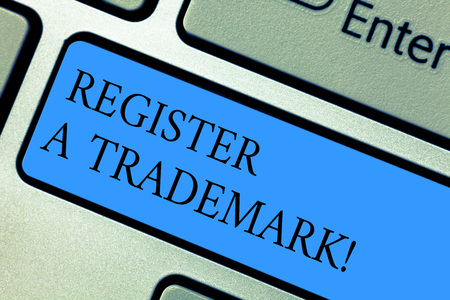 Conceptual hand writing showing Register A Trademark. Business photo showcasing To record or list as official company brand or  design Keyboard key Intention to create computer message idea 写真素材
