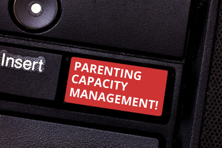 Text sign showing Parenting Capacity Management. Conceptual photo parents ability to protect children from risk Keyboard key Intention to create computer message pressing keypad idea