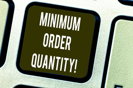 Conceptual hand writing showing Minimum Order Quantity. Business photo text lowest quantity of a product a supplier can sell Keyboard key Intention to create computer message idea Banco de Imagens