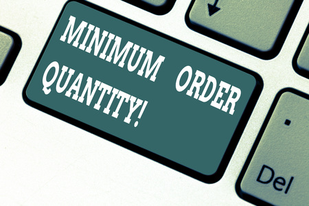 Writing note showing Minimum Order Quantity. Business photo showcasing lowest quantity of a product a supplier can sell Keyboard key Intention to create computer message pressing keypad idea Banco de Imagens