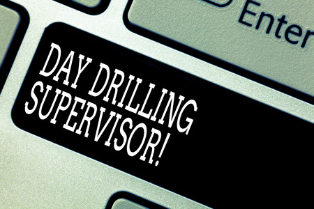 Text sign showing Day Drilling Supervisor. Conceptual photo In charge of the drill operators at a quarry Keyboard key Intention to create computer message pressing keypad idea Archivio Fotografico