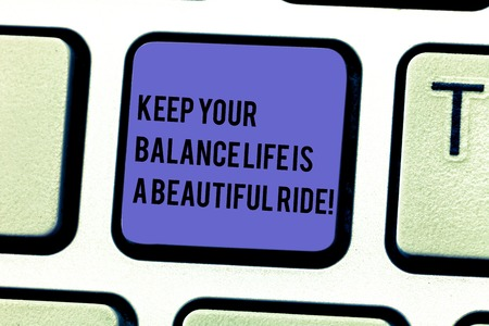 Writing note showing Keep Your Balance Life Is A Beautiful Ride. Business photo showcasing Combination of work and leisure Keyboard key Intention to create computer message pressing keypad idea Imagens